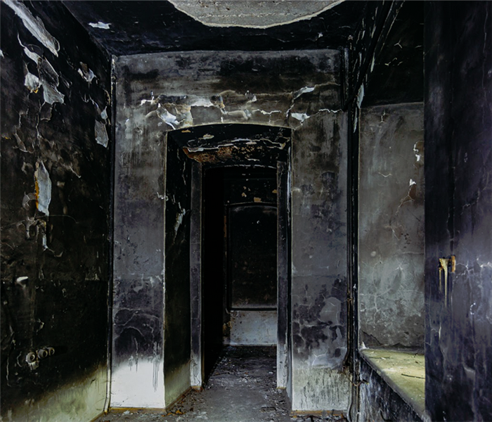 burned hallway in a house with soot covering it